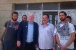 Senator John McCain with bearded jihadists. McCain entered Syria illegally to show support for the these terrorists.