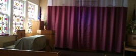Christian symbols are hidden behind a long curtain at this VA Chapel.